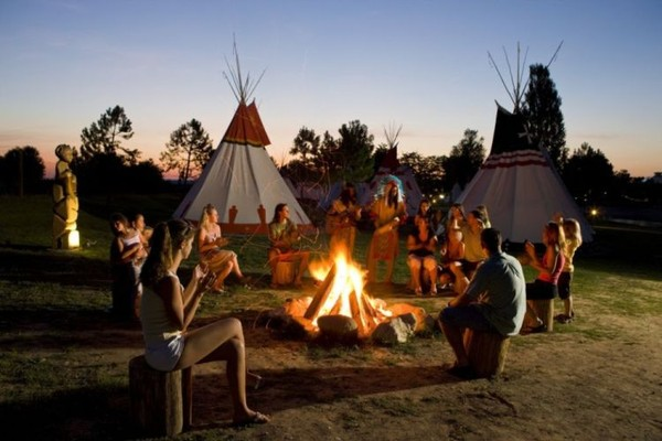 Around the fire tipi Village