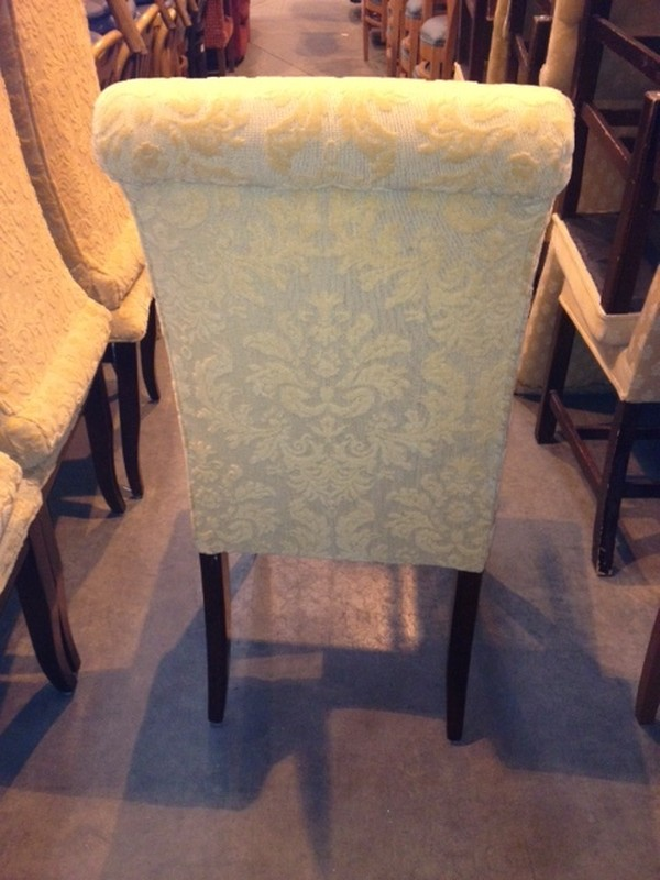 solid wood dining chair with yellow raised pattern fabric