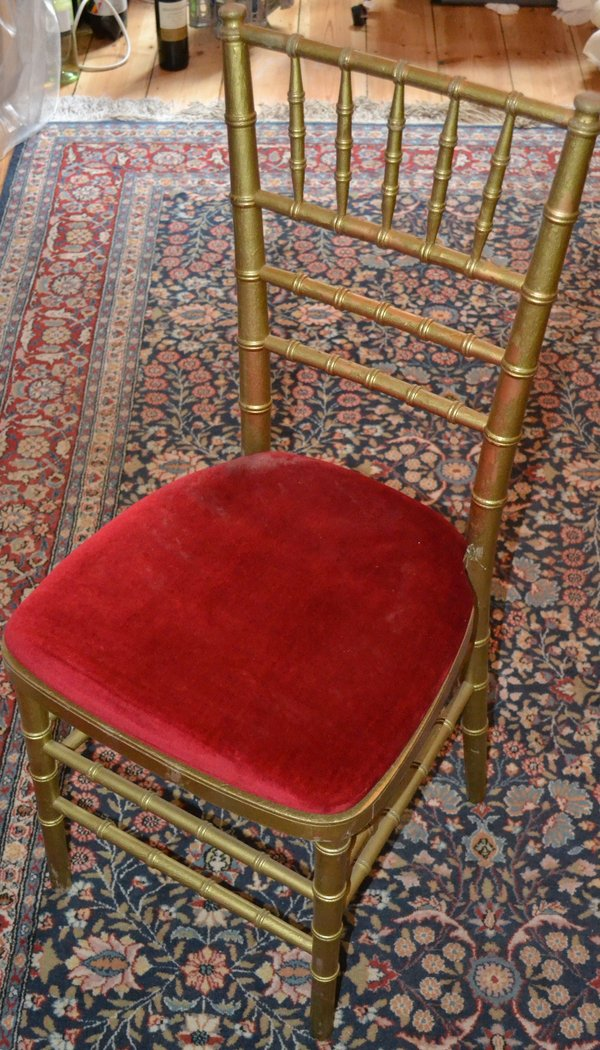 16 Gold chivari chairs with red pads