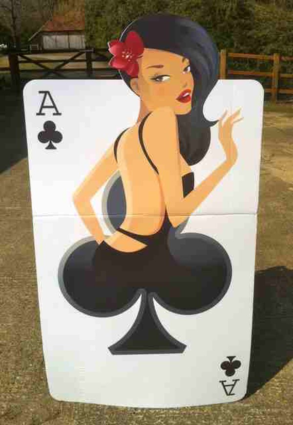 Girl in the club playing cards