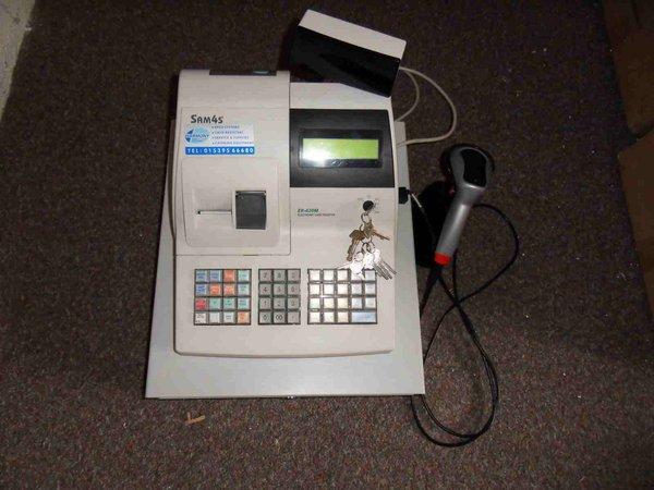 Cash register with bar code scanner