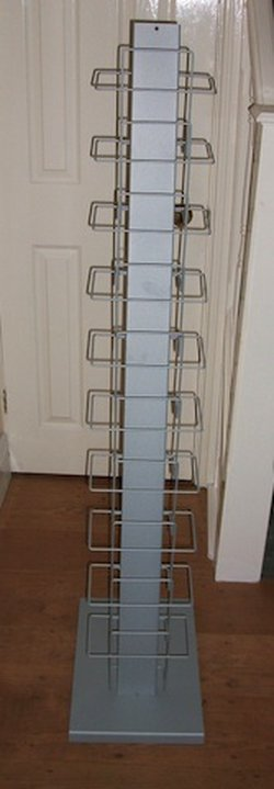 Literature rack made of steel and sprayed light grey