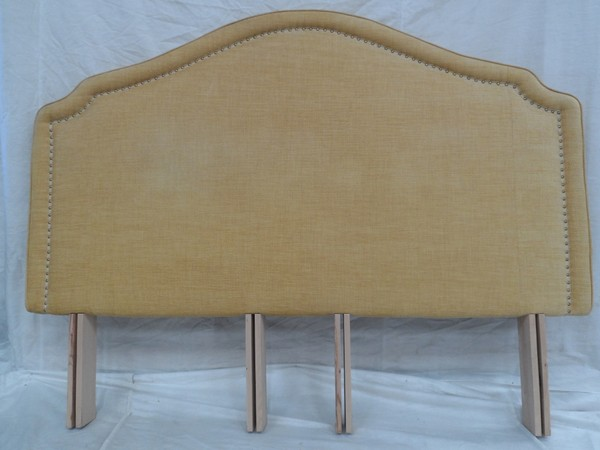 golden headboard with studded detailing