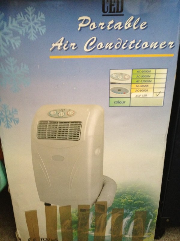 Portable air conditioner still in box