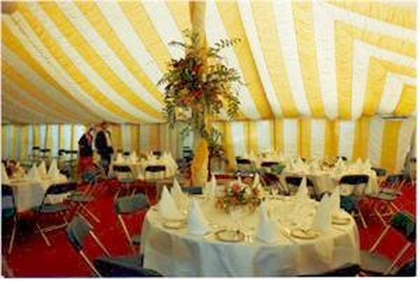 Yellow and white wedding marquee