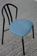 Black metal chair with blue cushion