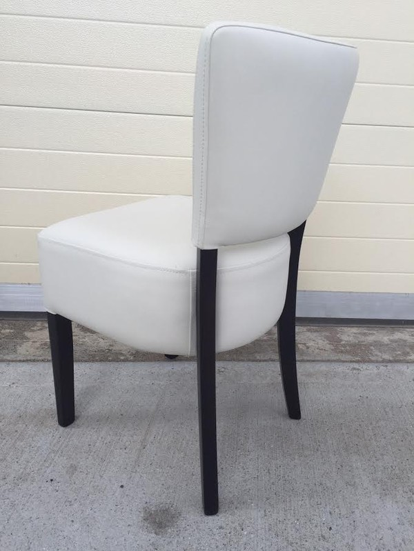 White faux leather chairs