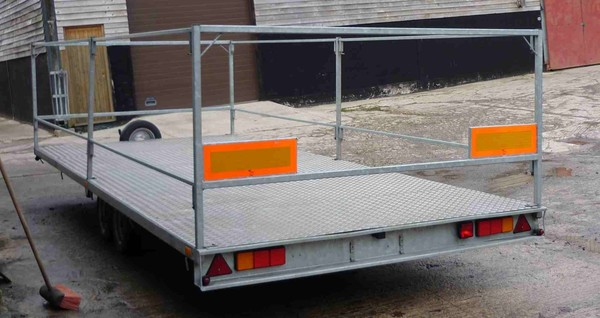 Large flat bed trailer with sides