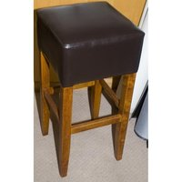 brown wooden bar stool with leather seat