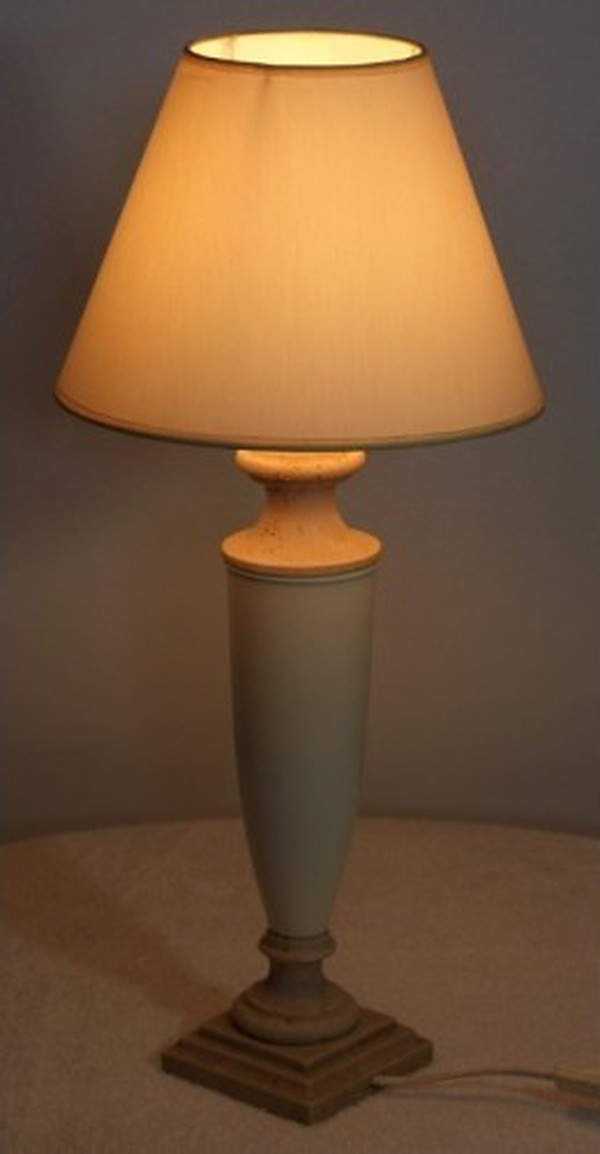 White bedside lamp lit up
