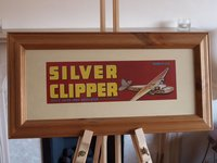 Wooden framed Silver clipper aircraft picture