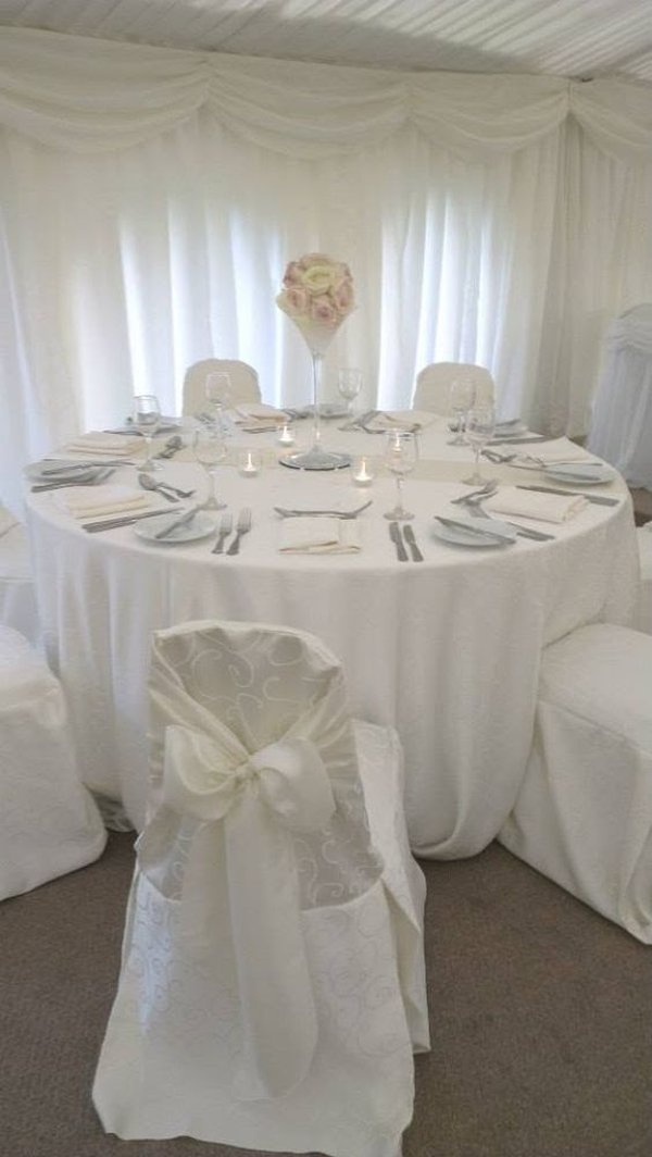 Ivory damask swirl chair covers