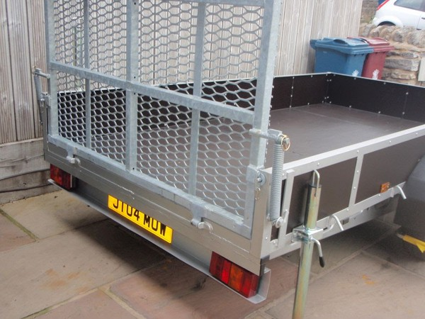 Spring assisted loading ramp