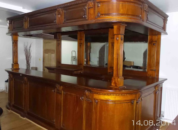 Freestanding solid mahogany bar and canopy including bar stools
