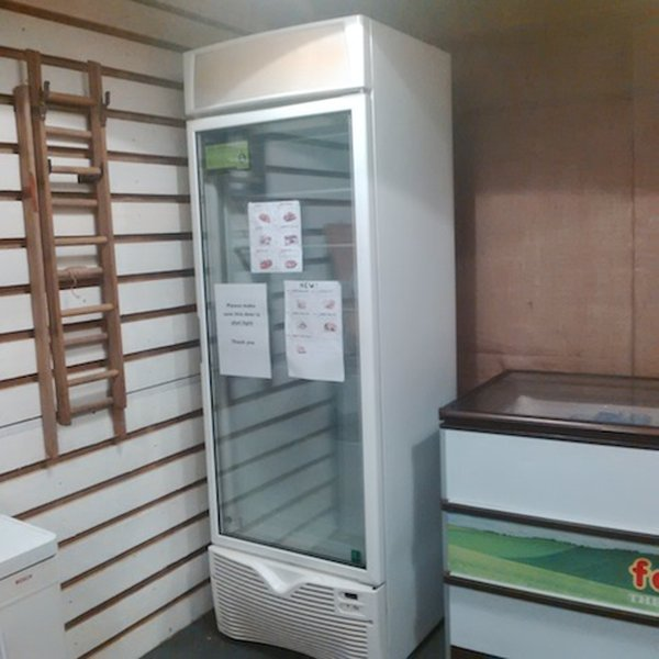 Framec upright display freezer with shelves.