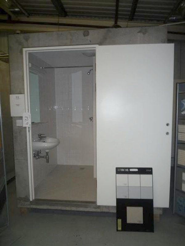 Concrete pod fitted out as a bathroom