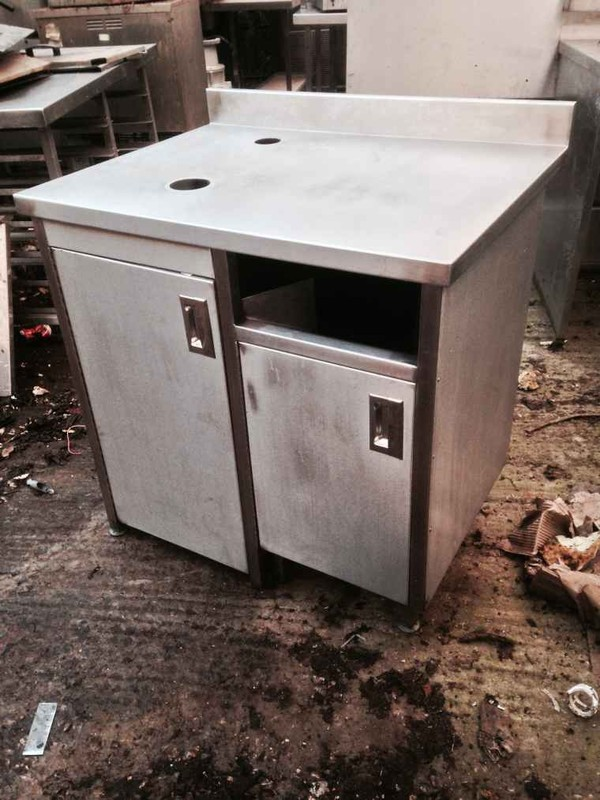 Stainless steel prep table with cupboard doors
