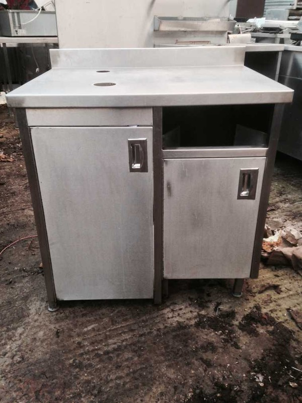 Stainless steel table with cupboard doors
