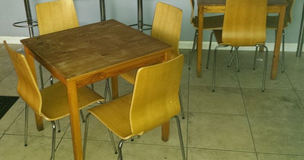 Wooden cafe chairs and table