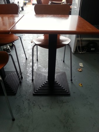 Tables with black stepped pedestal base