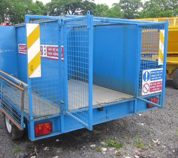 Single axle caged trailer with access doors