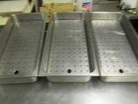 Stainless steel trays with sloping perforated inserts for draining