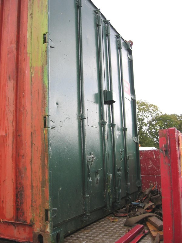 Shipping container with padlock door