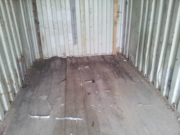 Shipping container with wooden floor