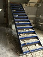 Metal mezzanine warehouse show room stairs fire escape enclosed steps