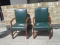 Green and Beige leather chair wooden arms