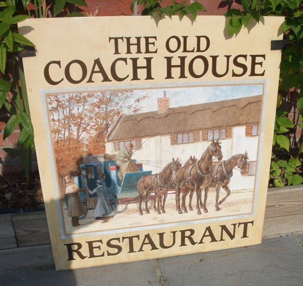 the old coach house restaurant sign