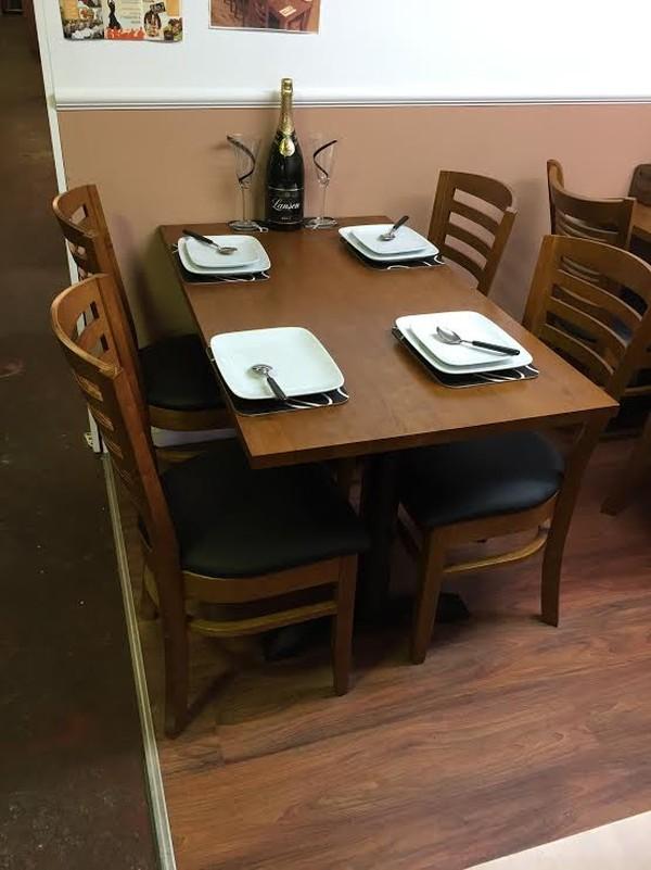 Oak restaurant table with cast iron base