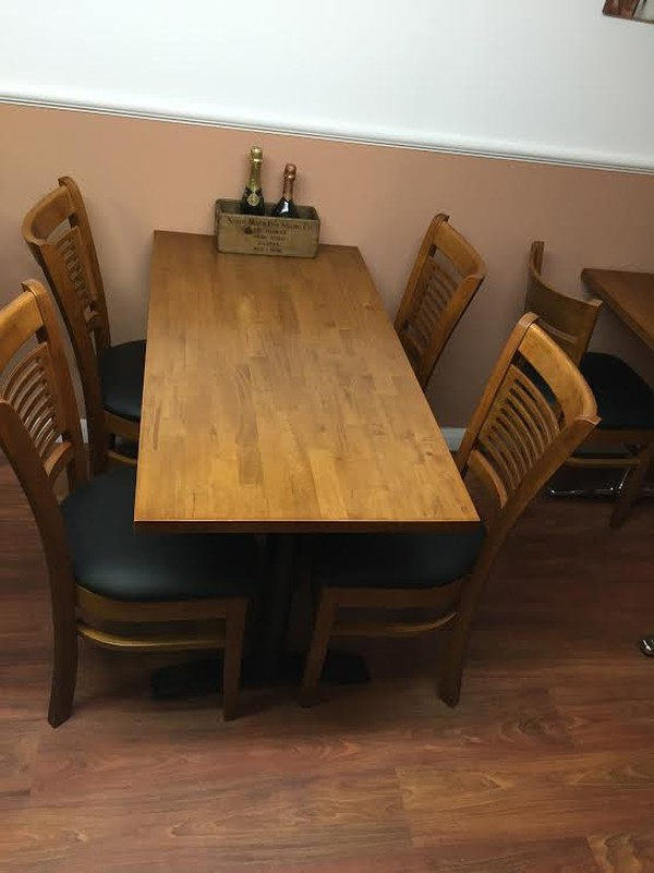 Restaurant table with black iron base