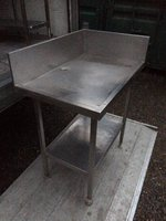 Stainless steel table with tall back