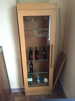 wooden bottle cabinet with installed light