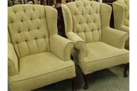 Pair of High Backed Winged Armed Chairs with Buttoned Back