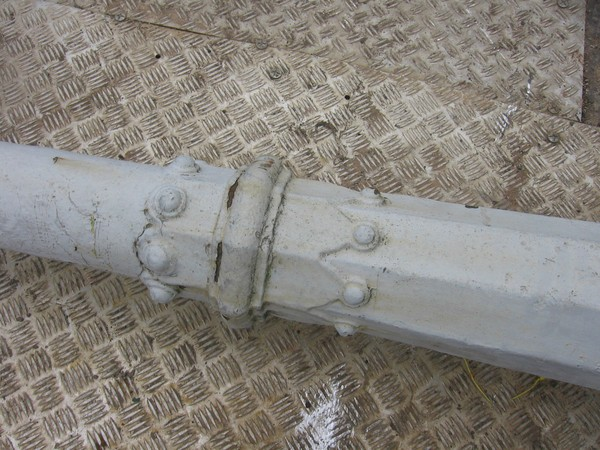 Traditional cast iron lamp post with hexagonal base and ladder rack