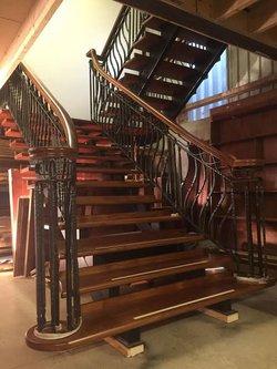Mahogany and wrought iron open tread staircase