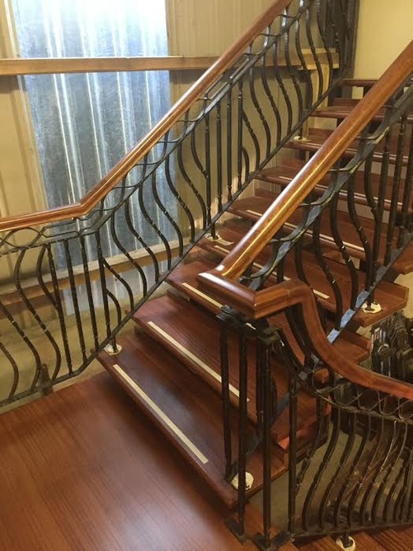 Large mahogany and wrought iron open tread staircase, return