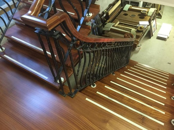 Mahogany and wrought iron open tread staircase, landing