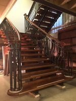 Mahogany and wrought iron open tread staircase