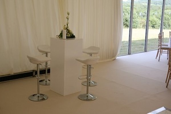 Ten White and chrome bar stools.