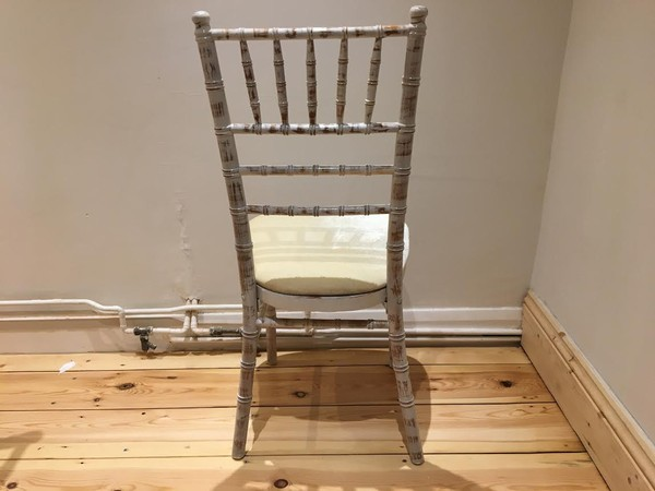 Limewash chivari banqueting chairs with ivory seat pad