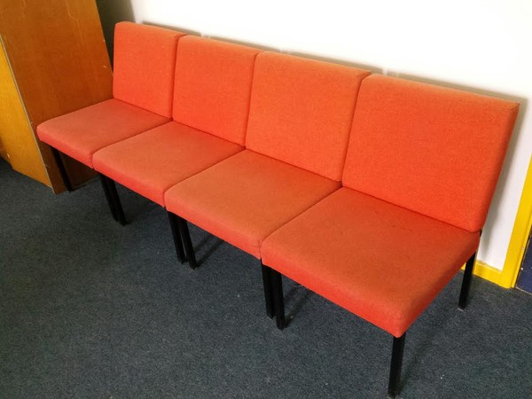 Orange waiting room chairs