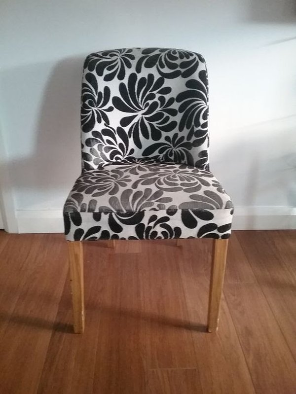 Dining chairs in black and white floral pattern