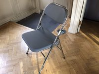 Folding chrome chairs with leather seats and back