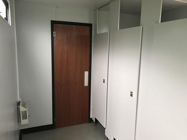 Door between ladies and gents
