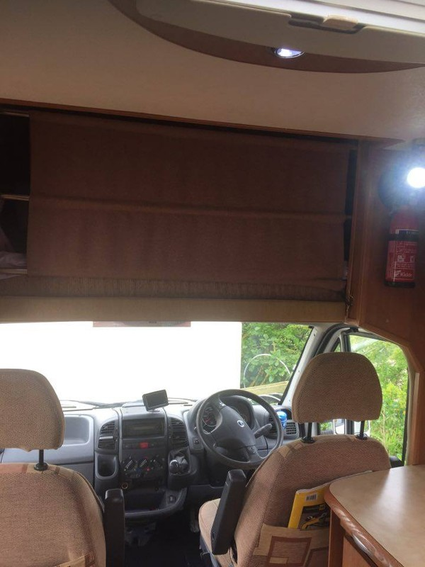 Over cab double bed with safety curtain