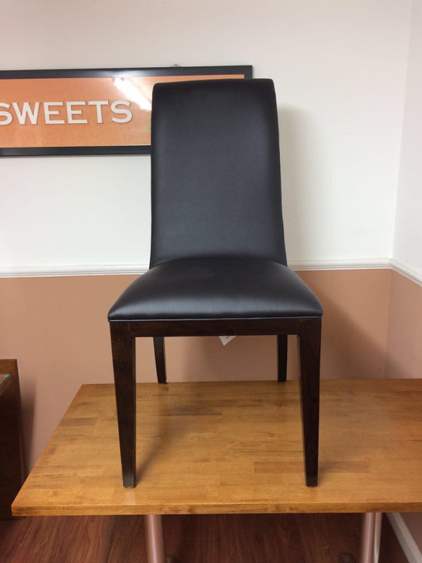 Dining chairs with darkwood brown legs back body and black or brown cushion padded seat