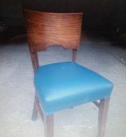 Wooden restaurant chair with blue seat